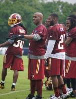 DeAngelo Hall and safety Ryan Clark communicate with fans.