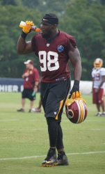 Linebacker Brian Orakpo takes a drink.