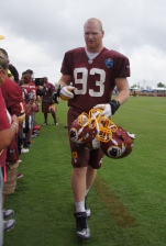 Rookie linebacker Trent Murphy greets fans after practice.