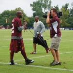 Cornerback DeAngelo Hall tries out his television skills.
