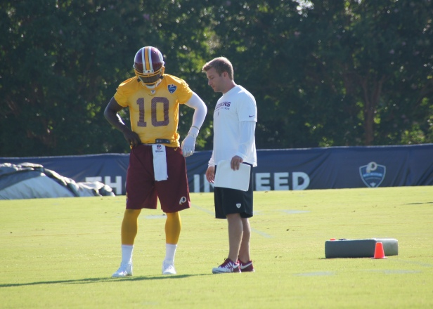 Robert Griffin III strategizes with offensive coordinator Sean McVay. Photo by Terri Russell.