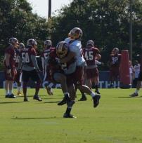 Linebacker Keenan Robinson picks off a Kirk Cousins pass intended for Roy Helu, Jr.. Photo by Terri Russell.