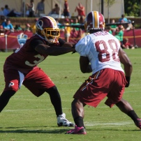 Cornerback David Amerson locks up with wide receiver Pierre Garcon. Photo by Jake Russell.