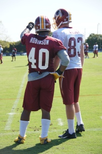Linebacker Adrian Robinson and Ted Bolser talk special teams. Photo by Jake Russell.