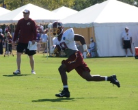 Wide receiver Rashad Ross returns a kickoff. Photo by Jake Russell.