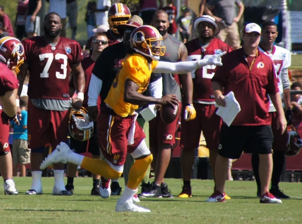 Robert Griffin III eludes defenders. Photo by Jake Russell.