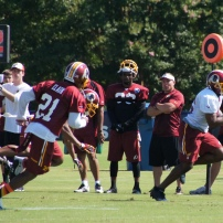 Running back Alfred Morris runs past the defense. Photo by Jake Russell.