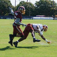 Cornerback Peyton Thompson knocks the football loose from wide receiver Rashad Ross. Photo by Jake Russell.