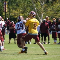 Quarterback Kirk Cousins looks for a receiver. Photo by Jake Russell.