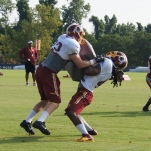 Tight end Ted Bolser lays out fullback Stephen Campbell during special teams drills. Photo by Terri Russell.