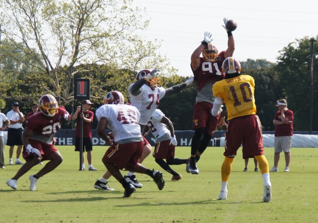 Ryan Kerrigan knocks down an RGIII pass. Photo by Terri Russell.