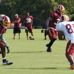 Santana Moss runs a route with cornerback E.J. Biggers in coverage. Photo by Jake Russell.