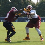 Offensive tackle Trent Williams takes on linebacker Brian Orakpo in blocking drills. Photo by Jake Russell.