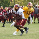Running back Alfred Morris takes the handoff from Griffin. Photo by Jake Russell.