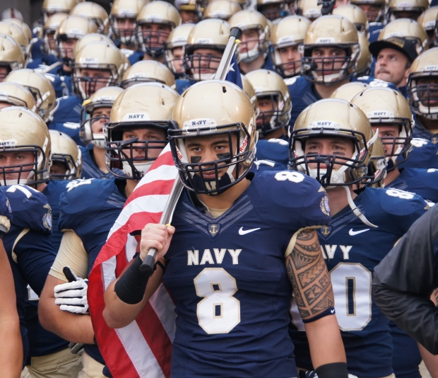 Former Navy safety Wave Ryder waits for the Midshipmen to be introduced before their game against South Alabama.