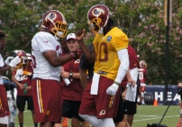 Quarterback Robert Griffin III and fullback Darrel Young work on their handshake. Photo by Terri Russell.