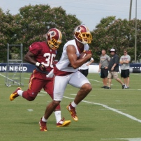 Tight end Jordan Reed runs past safety Kysheon Jarrett. Photo by Jake Russell.