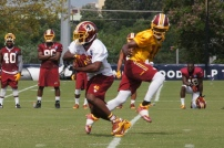 Running back Alfred Morris takes a handoff from quarterback Robert Griffin III. Photo by Jake Russell.