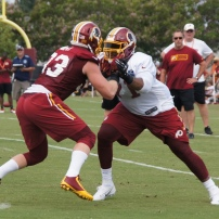 Offensive tackle Trent Williams battles linebacker Trent Murphy. Photo by Jake Russell.