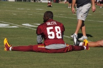 Linebacker Junior Galette stretches as practice comes to a close. Photo by Terri Russell.