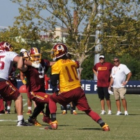 Quarterback Robert Griffin III drops back to pass. Photo by Terri Russell.