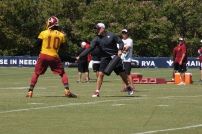 Quarterback Robert Griffin III performs a pass pressure drill. Photo by Terri Russell.
