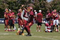 Redskins safety Kyshoen Jarrett dances to music before the start of practice. Photo by Terri Russell.