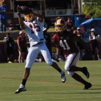 Wide receiver Colin Lockett makes a catch in front of safety Phillip Thomas. Photo by Terri Russell.