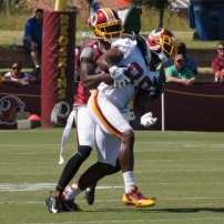 Wide receiver Pierre Garcon makes a catch against cornerback David Amerson. Photo by Jake Russell.