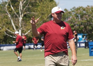 Head coach Jay Gruden salutes the crowd. Photo by Terri Russell.