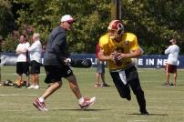 Quarterback Kirk Cousins runs a drill. Photo by Jake Russell.