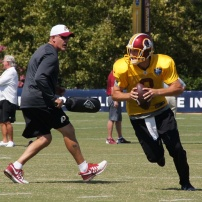 Quarterback Kirk Cousins runs a drill. Photo by Jake Russell.
