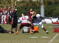 Running backs Alfred Morris and Matt Jones take part in a drill. Photo by Jake Russell.