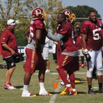 Linebacker Junior Galette works on technique with defensive end Corey Crawford. Photo by Jake Russell.