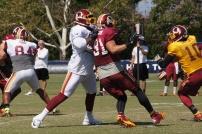 Offensive tackle Trent Williams blocks linebacker Ryan Kerrigan. Photo by Jake Russell.