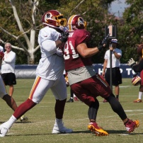 Offensive tackle Trent Williams blocks linebacker Ryan Kerrigan. Photo by Jake Russell.