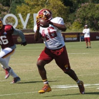 Running back Alfred Morris looks upfield after making a catch. Photo by Jake Russell.