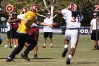 Running back Matt Jones takes a handoff from quarterback Kirk Cousins. Photo by Jake Russell.