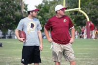 Head coach Jay Gruden and his son, Jack, look on during practice. Photo by Jake Russell.