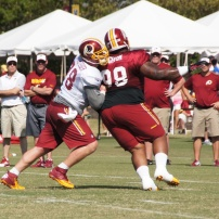 Center Kory Lichtensteiger blocks defensive tackle Terrance Knighton. Photo by Jake Russell.