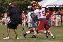 Offensive tackle Brandon Scherff takes on linebacker Preston Smith. Photo by Jake Russell.