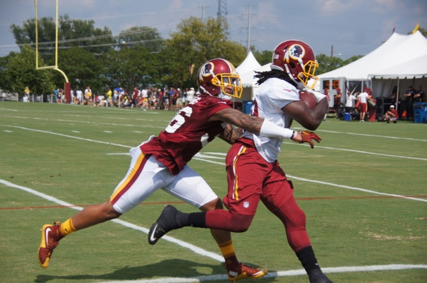 Su'a Cravens attempts to tackle Keith Marshall. (Photo by Jake Russell)
