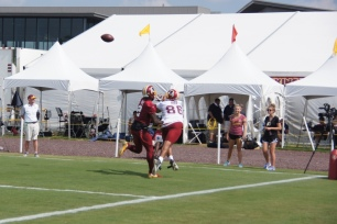 Jordan Reed attempts to make a catch against DeAngelo Hall. (Photo by Jake Russell)