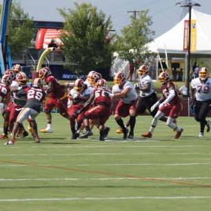 The Redskins defense pursues the runner. (Photo by Jake Russell)