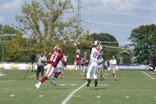 Chris Thompson makes the catch in front of Will Compton. (Photo by Jake Russell)