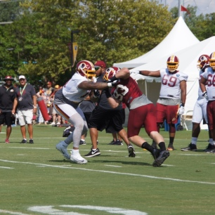 Trent Williams blocks Trent Murphy. (Photo by Jake Russell)