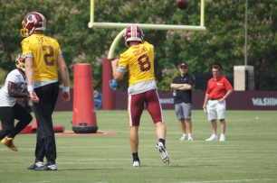 Quarrterback Kirk Cousins delivers a throw. (Photo by Jake Russell)