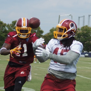 Tight end E.J. Bibbs bobbles a pass in front of safety Will Blackmon. (Photo by Jake Russell)