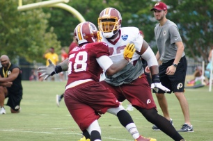 Linebacker Junior Galette takes on offensive tackle Ty Nsekhe. (Photo by Jake Russell)