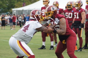 Tight end Niles Paul and linebacker Pete Robertson participate in a drill. (Photo by Jake Russell)